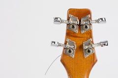 Strumento di musica delle ukulele sui precedenti bianchi Fotografia Stock
