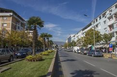 Strumica, Macedonia - street in the center of the city. Palm trees and cars stock photos