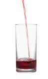 Strumień sok płynie w szkle Fotografia Royalty Free