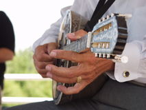 Strumming. Greek Balalaika Royalty Free Stock Photo