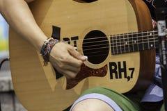Strumming the guitar. Stock Photo
