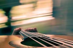 Strumming Guitar Stock Photo