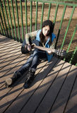Strumming the gutar outdoors. Stock Images