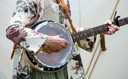 Strumming an old banjo Royalty Free Stock Photography