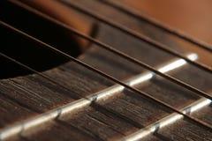 Strums della chitarra Fotografia Stock