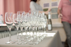 Strung champagne glasses Stock Images
