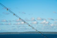 Strung Lights and Island View Royalty Free Stock Photo
