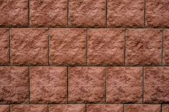 Struttura alta vicina del fondo della macrofotografia dei mattoni rossi quadrati della parete Immagine Stock Libera da Diritti