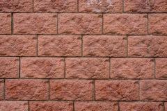 Struttura alta vicina del fondo della macrofotografia dei mattoni rossi rettangolari della parete Fotografia Stock