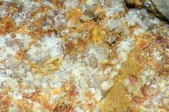 Struttura approssimativa della pietra rossa e arancio immagine stock