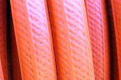 Struttura arancio del tubo flessibile Immagine Stock