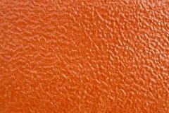 Struttura arancione del leatherette Immagini Stock