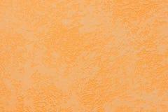 Struttura arancione della parete dell'intonaco Priorità bassa strutturata Immagine Stock Libera da Diritti