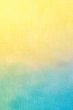 Struttura astratta blu e gialla dipinta sul backgroun della tela da dipinto Immagini Stock Libere da Diritti