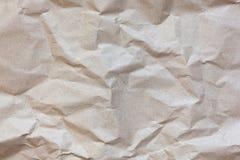 Struttura astratta Fondo sgualcito della carta marrone del mestiere Copi lo spazio per testo orizzontale DIY, artigianato, di nuo fotografie stock