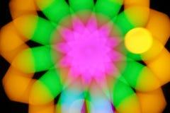 Struttura astratta vaga del bokeh di colore su fondo nero fotografie stock