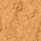 Struttura bagnata senza cuciture della sabbia spiaggia, fondo Fotografia Stock