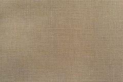 Struttura beige crema di tessuto o della materia tessile Fotografia Stock