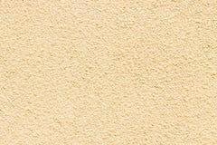 Struttura beige della facciata della pittura su una casa della famiglia Fotografie Stock