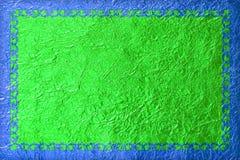 Struttura blu brillante con un modello sui precedenti verdi della stagnola immagine stock