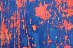 Struttura blu ed arancia afflitta di rosso, del metallo del fondo Immagine Stock Libera da Diritti