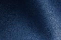 Struttura blu scuro del cuoio sintetico con le ombre Fotografia Stock Libera da Diritti