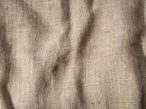 Struttura corrugata del fondo della tela di sacco fotografie stock libere da diritti
