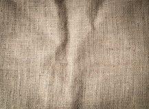 Struttura corrugata del fondo della tela di sacco fotografia stock