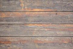Struttura dai bordi di legno anziani con le tracce di pittura arancio pulita fotografia stock libera da diritti