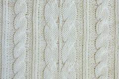 Struttura dei vestiti tricottati bianchi caldi di inverno fotografia stock libera da diritti