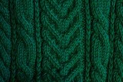 Struttura dei vestiti tricottati verdi caldi di inverno fotografia stock