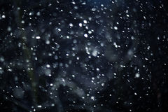 Struttura del bokeh della neve su fondo nero Immagini Stock