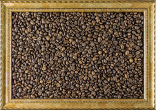 Struttura del chicco di caffè dalla bella vista del fondo dell'immagine il lato Concetto Fotografia Stock