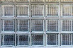 Struttura del fondo dei blocchi di vetro in una parete Fotografia Stock