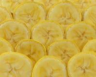 Struttura del fondo dei pezzi affettati della banana Immagini Stock Libere da Diritti