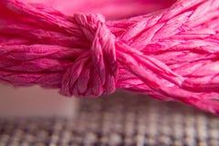 Struttura del fondo della corda rosa con il nodo concetto e progettazione immagine stock libera da diritti