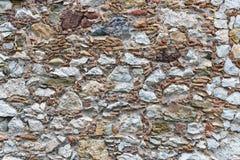 Struttura del fondo della parete con parecchi generi di pietre Fotografia Stock Libera da Diritti