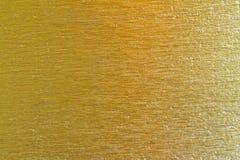 Struttura del fondo graffiata ottone dorato del metallo Fotografie Stock