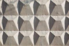 Struttura del fondo del recinto concreto grigio con il modello quadrato immagine stock