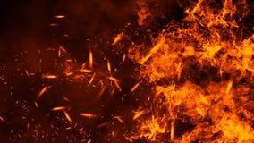 Struttura del fuoco dell'ustione Fiamme su fondo nero isolato Struttura per l'insegna, aletta di filatoio, carta fotografia stock