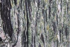 Struttura del granito - gli strati di marmo progettano la lastra di pietra verde e grigia Fotografia Stock