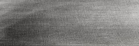Struttura del nero del tessuto del denim Fondo del velluto dei jeans dell'indaco Fotografie Stock