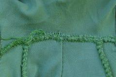 struttura del panno da vecchio tessuto sgualcito con la cucitura fotografia stock