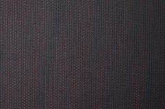 Struttura del panno nero con i puntini rossi Fotografia Stock