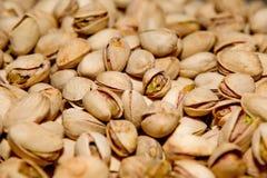 Struttura del pistacchio Noci Pistacchi freschi verdi come struttura Roasted ha salato l'alimento delizioso sano dei pistacchi Fotografia Stock