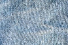 Struttura del primo piano blu-chiaro dei jeans Immagini Stock