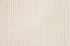 Struttura del primo piano della carta a strisce della crema leggera con le piccole inclusioni per l'acquerello ed il materiale il Fotografie Stock
