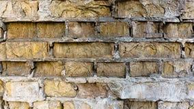 Struttura del primo piano della parete di pendenza del mattone del blocco vecchia fotografia stock libera da diritti
