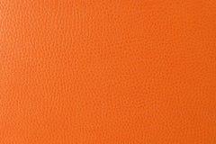 Struttura del primo piano di cuoio artificiale arancione Immagini Stock Libere da Diritti