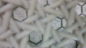 Struttura del reticolato della materia plastica su sfuocatura Fotografia Stock